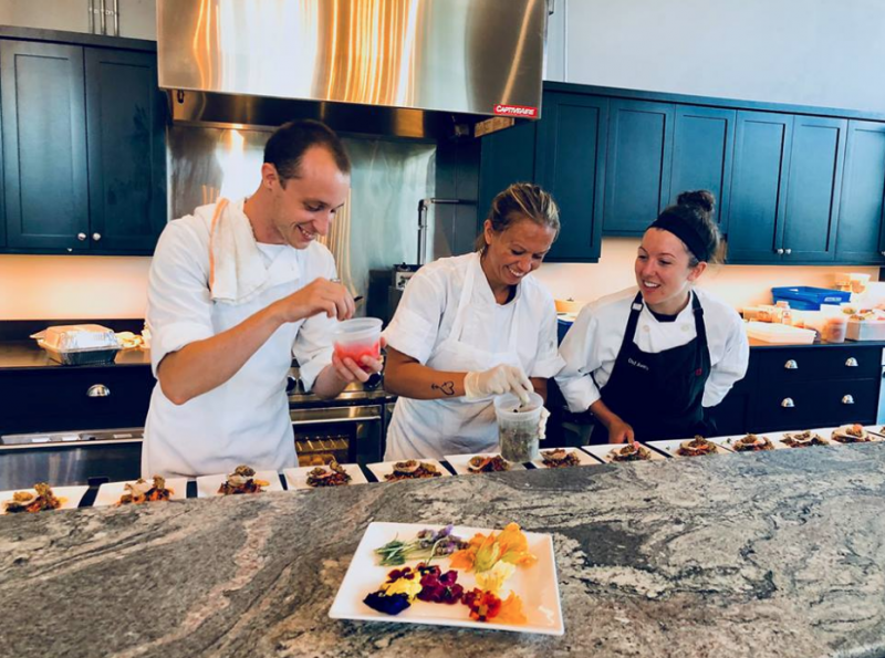 Chefs Avery, Andy and Kelly prepping one of the many Maine Harvest courses. — at Cellardoor Winery at The Point.